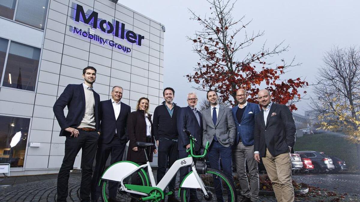 Representanter fra Møller Mobility Group, Selvaag Invest og Urban Infrastructure Partner som sammen skal bygge ut sykkeldelingstjenester i storbyene.